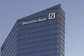 Deutsche Bank reports sharp fall in profits