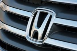 Honda profit falls on air bag recall