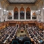 Canada votes to expand spy powers after attack on parliament