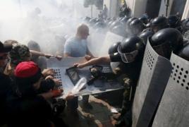 100 police injured in Ukraine's Kiev protest blast after MPs vote
