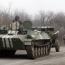 Ukraine, pro-Russian rebels start withdrawing weapons