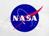 NASA says Pluto has blue skies, surface water ice