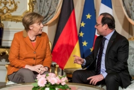 Merkel, Hollande agree refugee crisis needs EU solution