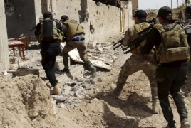 Iraq's latest advances reconnect Ramadi to key base, Baghdad