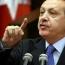 Erdogan warns constitutional court on journalists release