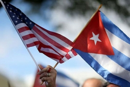U.S. eases trade, travel restrictions on Cuba ahead of Obama visit