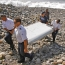 Australia to examine 3 new pieces of debris possibly from flight MH370