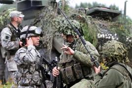 Глава МИД ФРГ подверг критике учения НАТО в Восточной Европе