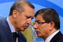 German lawsuit accuses Turkey's Erdogan, Davutoglu of war crimes
