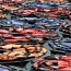 Chinese artist Ai Weiwei's refugee life jackets in Vienna palace pond