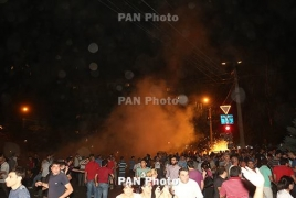 Police disperse Yerevan protesters after violent night