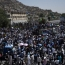 At least 61 killed as powerful blast rips through Kabul protest