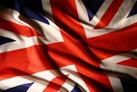 Britain defends decision to review $24 billion nuke plant
