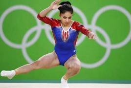 Гимнастка Седа Тутхалян в составе российской сборной выиграла олимпийское серебро