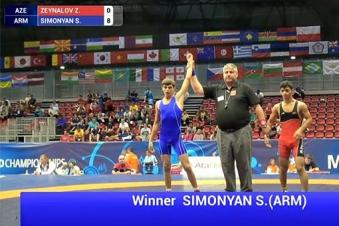 Armenian wrestler defeats Azerbaijani athlete at World Championship