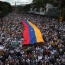 Venezuela govt. says foils coup after massive protest march