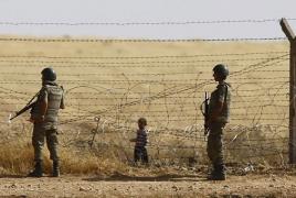 Турция обвиняет курдов в попытке помешать строительству стены на границе с Сирией