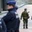 Belgian prosecutors link police stabbing to terrorism