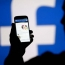 Facebook shares tumble amid slow growth warnings