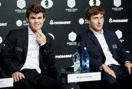 Норвежец Карлсен подтвердил титул чемпиона мира по шахматам