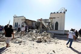 Women suicide bombers kill four Libyan troops