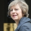 May wants early deal in Brexit talks on status of Britons in Europe