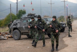 Serbs tear down contested wall in Kosovo