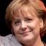 Merkel urges Putin to help end violence in eastern Ukraine