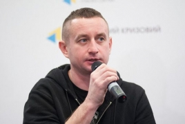 Prominent Ukrainian author seized in Belarus, ordered to leave