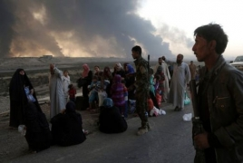 Iraqi forces secure key Mosul bridge as thousands of civilians flee