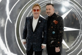 "Elton John introduces ""The Promise"" Genocide drama at Oscar party"