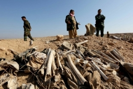 Iraq paramilitary forces say mass grave of hundreds found