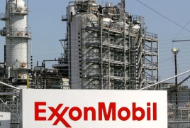 Exxon Mobil urges Trump against abandoning Paris climate accord