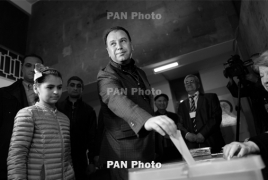 Defense minister casts ballot, expects incident-free election day