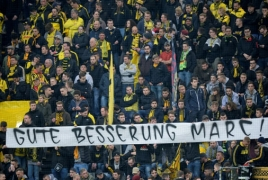 Monaco fans in Dortmund's black and yellow in show of solidarity