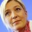 French presidential hopeful Le Pen pledges to suspend immigration