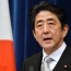 Japan's Abe says wants to resolve territorial row with Russia