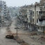Syrian rebel groups fight each other in besieged Damascus enclave