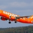 EasyJet orders bigger planes to keep costs down