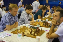 Hrant Melkumyan closely trailing European Chess Championship leader