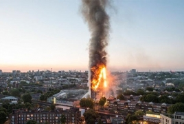 Число погибших при пожаре в многоэтажном доме в Лондоне возросло до 12 человек