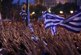 Greek central bank cuts growth outlook, warns of risks