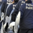 Brussels police arrest four, find arms cache