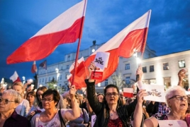 Polish president vetoes judicial reforms after nationwide protests