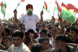 Iraqi Kurdistan offers truce, freezes referendum