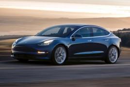 Tesla delays Model 3 production as shares plunge