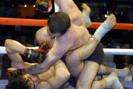 Armenian fighter 'puts opponent  to sleep' at Fight Nights Global 80