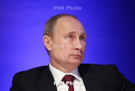 Putin on surprise visit to Syria, orders withdrawal of Russian troops
