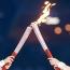 В эстафете олимпийского огня впервые принял участие робот