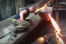Armenian puts bare hand through boiling ore and is left uninjured
